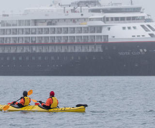 silversea silver cloud with kayakers