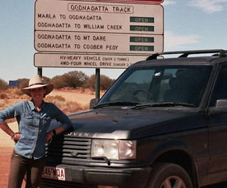 Writer Sam Aldenton at the start of the Oodnadatta Track just outside of Marla on her outback road trip.