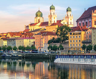 APT river cruise ship docked near Passau, Germany at sunset.