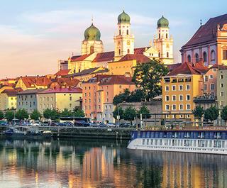 APT river cruise ship docked near Passau, Germany at sunset.