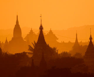A golden sunset over the temples of Bagan in Myanmar.