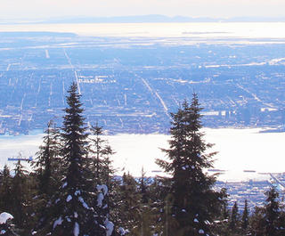 Vancouver City from the Skyride gondola on Grouse Mountain