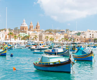 Malta coastline with boats anchored.