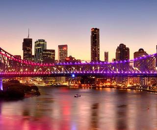 Brisbane's skyline, featuring the Story Bridge, at twilight.