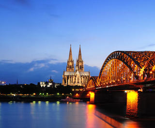 Cologne Cathedral and Great St Martin Church, the Rhine at twilight.