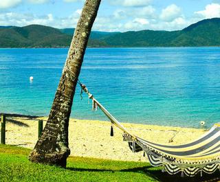 A hammock slung between two trees on Daydream Island, Queensland.
