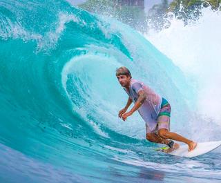 Bali surfer on waves.