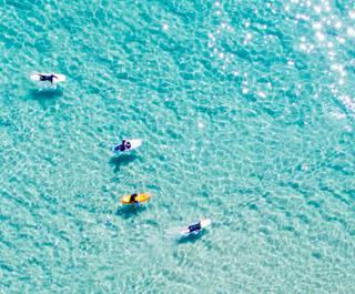 Clear blue beach waters.
