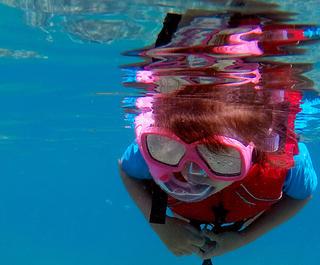 Child snorkelling in Fiji