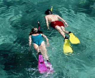 two snorkellers from above in ocean