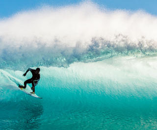 surfer riding breaking wave