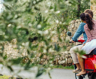 couple on moped in italian countryside