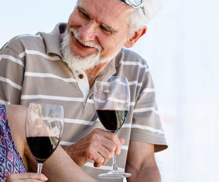 couple drinking red wine on boat