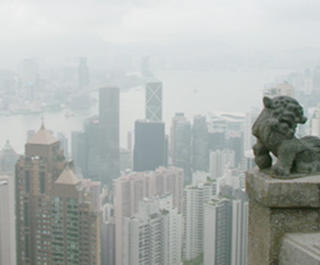 A male and female look at the view from Hong Kong's The Peak.