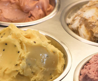 A selection of ice cream in tubs.