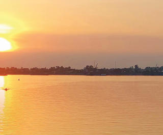 A brilliant sunset on a cruise of the Mekong River through Vietnam and Cambodia