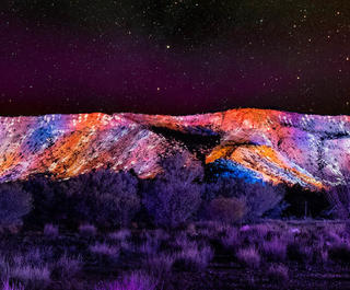 MacDonnell Ranges illuminated during the Parrtjima: Festival in Light in the Northern Territory.