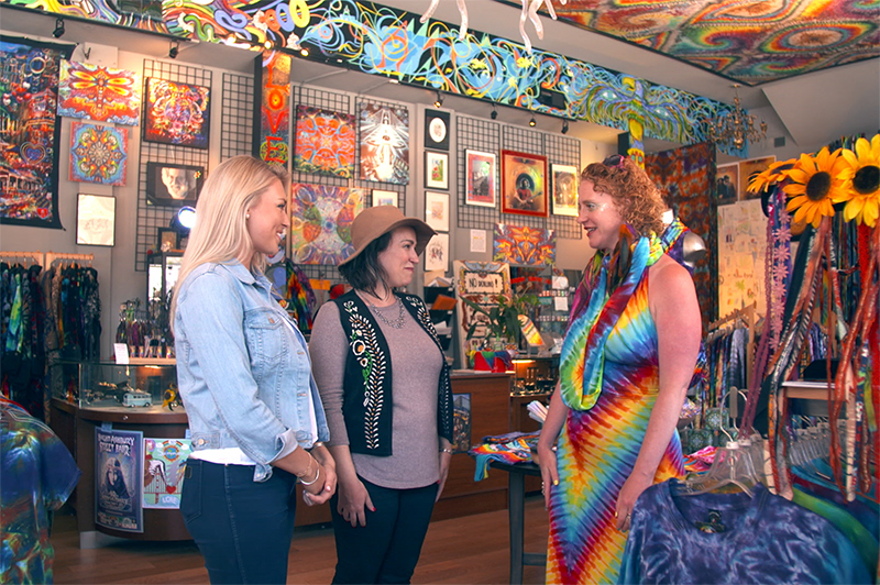 Three women stand inside the Love on Haight shop in San Francisco.