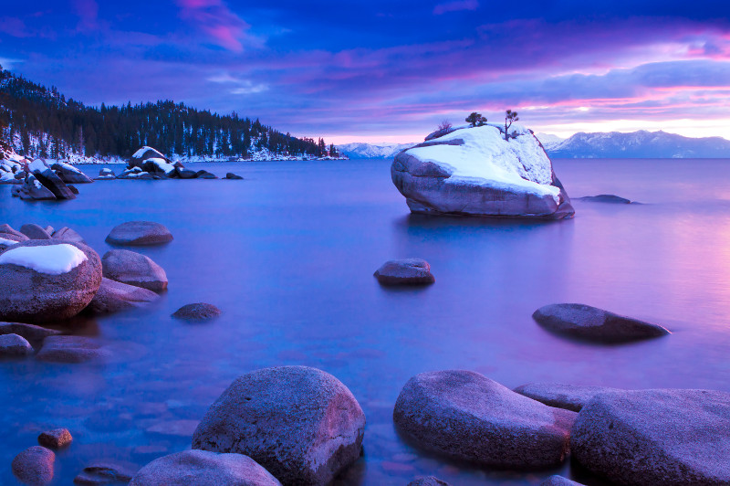 Lake Tahoe at sunrise with a light dusting of snow.