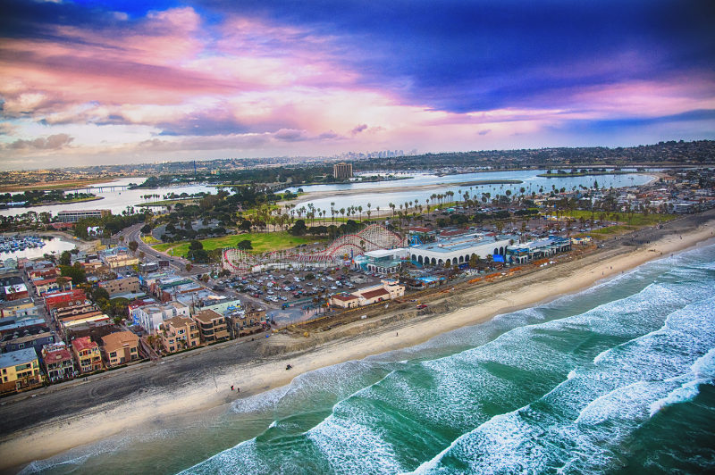 An aerial view of San Diego as the waves roll in.