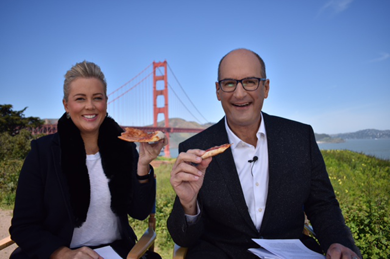 Samantha Armytage and David Koch eat pizza in front of the Golden Gate Bridge in San Francisco, USA.