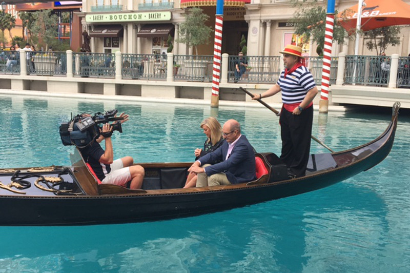 A cameraman films Sunrise hosts Samantha Armytage and David Koch, as well as a gondolier, in a gondola at The Venetian in Las Vegas, USA.
