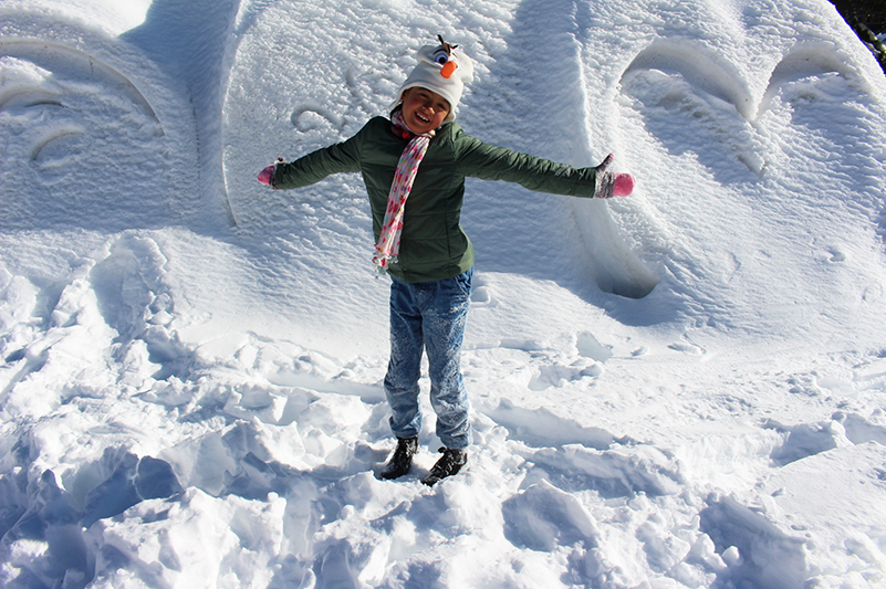 Child in snow at Grouse Mountain in winter