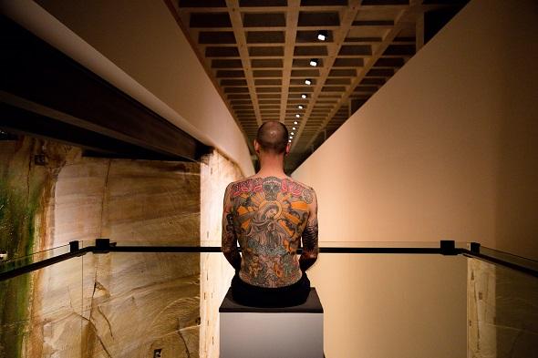 man with tattoos exhibit mona hobart
