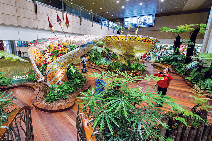 The colourful Enchanted Garden in Terminal 2. (Image: Changi Airport)