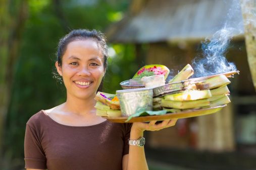 Balinese woman carrying food