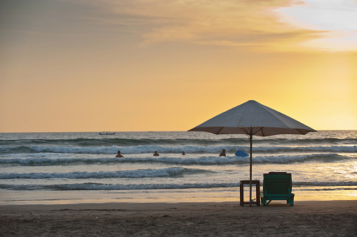 Sun lounger under umbrella on Legian Beach Bali Indonesia