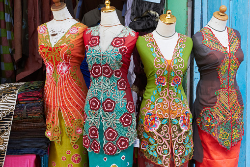 sarongs on mannequins at market bali indonesia