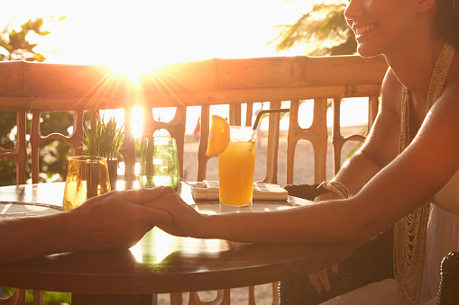 Couple with drinks in Bali, Indonesia