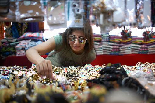 Woman browsing souvenirs Bangkok Thailand