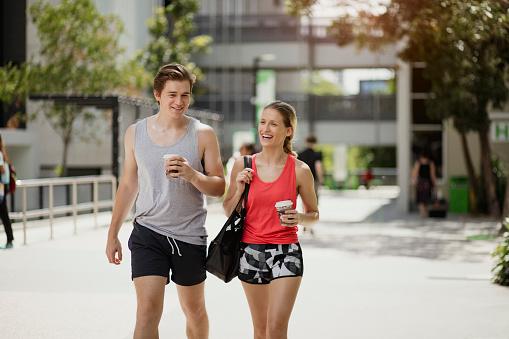 Young Couple Holding Coffee Brisbane Australia