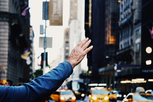 Man hailing cab in new york