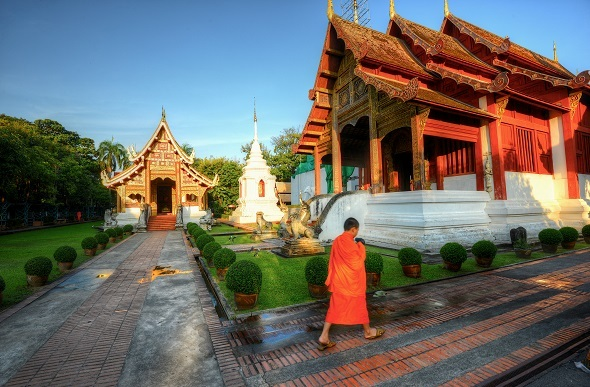 thai temple with man infront