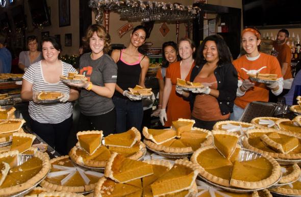 A group of volunteers serving pumpkin pie