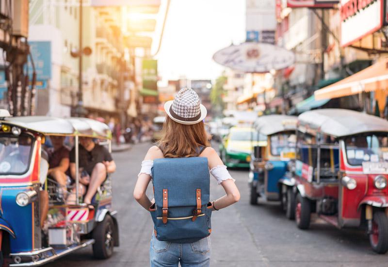 woman in bangkok walking down street