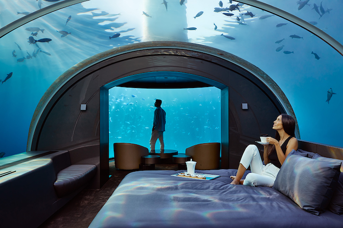 a couple stays in the muraka's underwaters suite - romantic travel experiences for valentines day