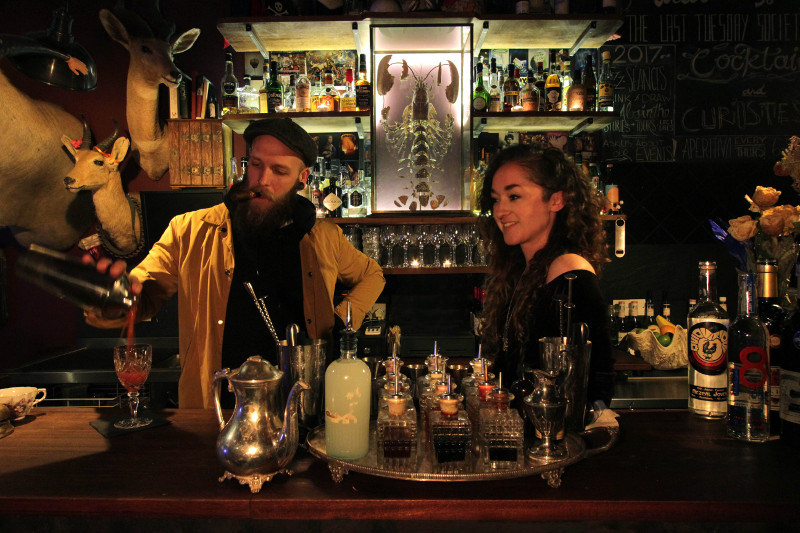 man and a woman tending bar