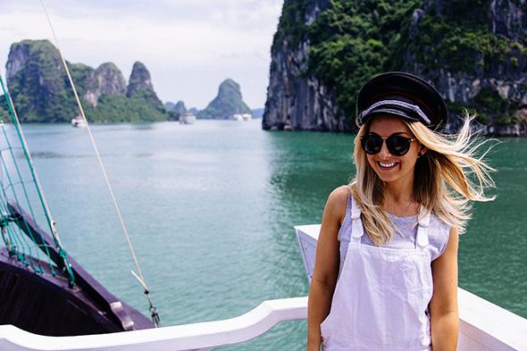 female traveller smiling in halong bay