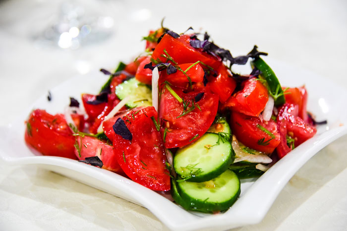 a classic Uzbeki salad of onions and tomatoes