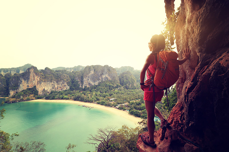 woman hiking railay bay in thailand