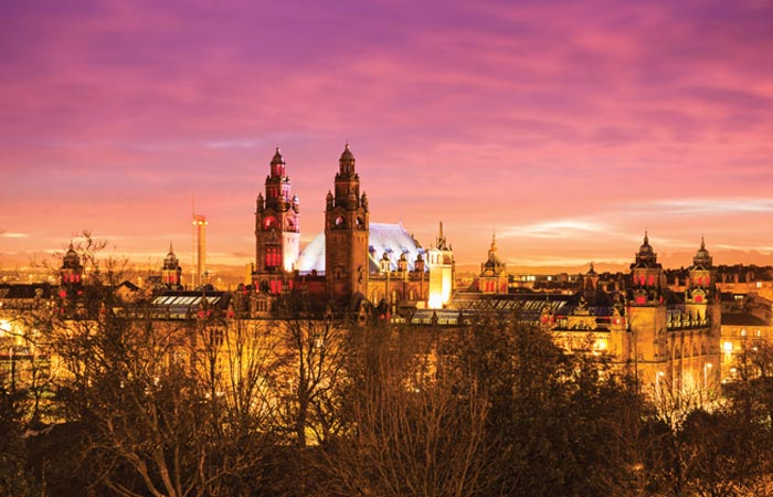 Kelvingrove museums silhouetted against a sunset sky