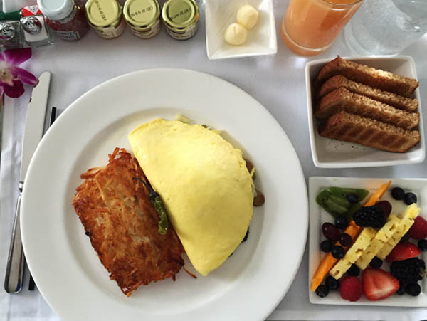 Breakfast of omelelet your way, Russet and Yukon gold potato cake and fresh fruit salad at the Modern Honolulu