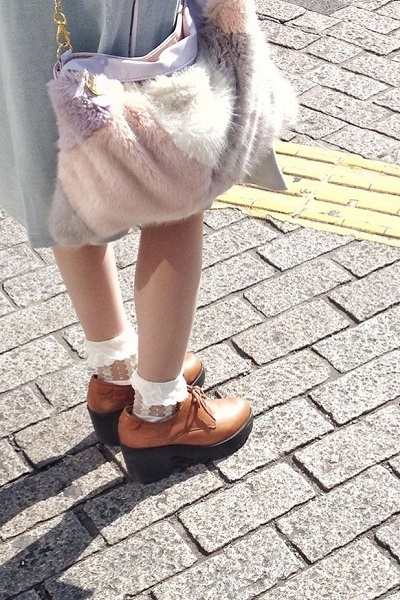 girls shoes and socks standing at crossing
