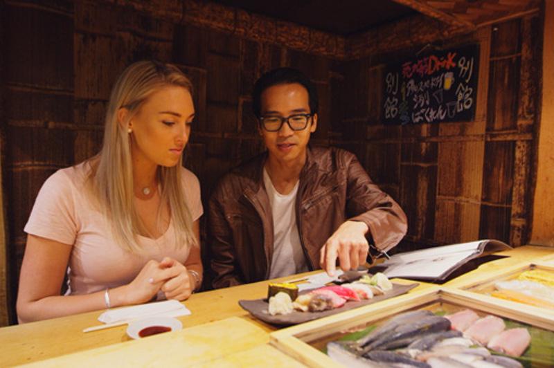 Greer and Keiichi in fish market restaurant, tokyo, japan