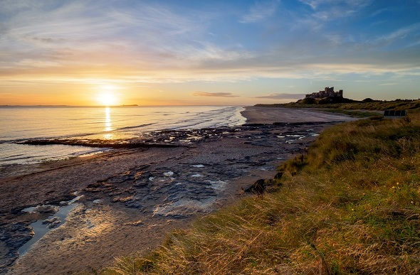 sunrise on bamburgh beach uk