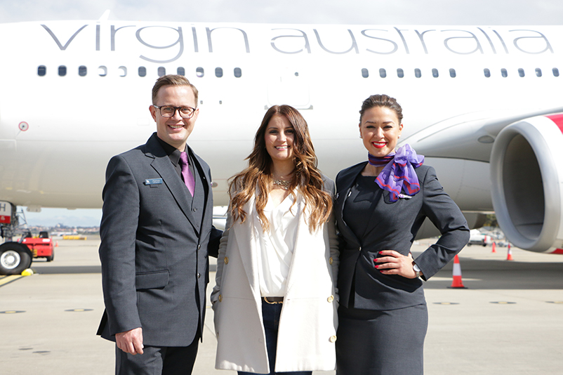 Virgin Australia staff pose in front of plane